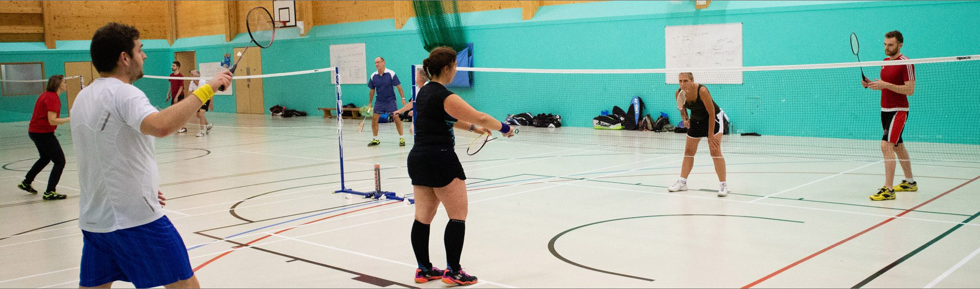 People playing mixed badminton at Keynsham Badminton Club